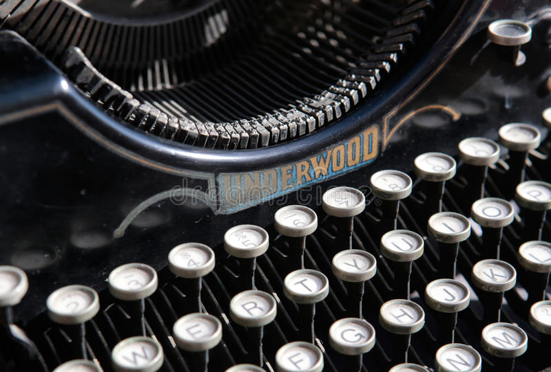 Antique typewriter from beginning 20th century at industry exhibit in an art gallery. Antique typewriter from beginning 20th century shown at a industry antique royalty free stock photos