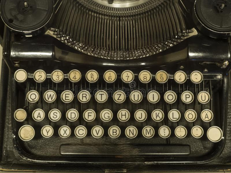 Antique typewriter keyboard from the ancient history.  royalty free stock photo