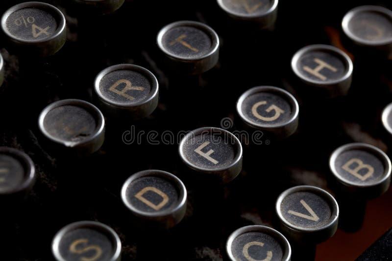 Antique typewriter keys. Close up photo of antique typewriter keys with dust, shallow focus royalty free stock photo