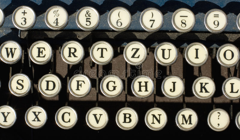 Antique typewriter keys. On black useful for background stock photos
