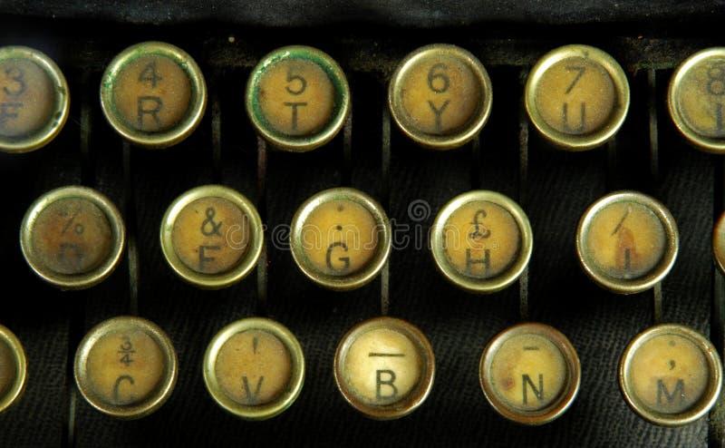 Antique Typewriter Keys. Rows of old yellowed keys on an antique typewriter royalty free stock photos