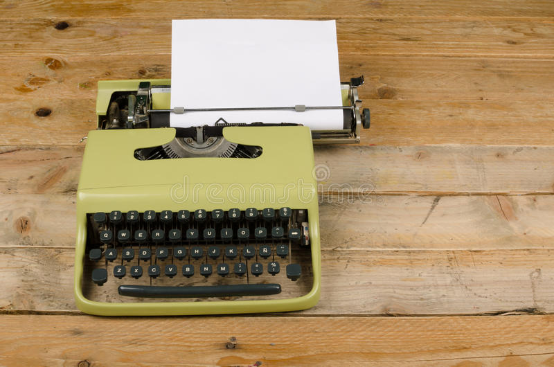 Antique typewriter with paper royalty free stock photography