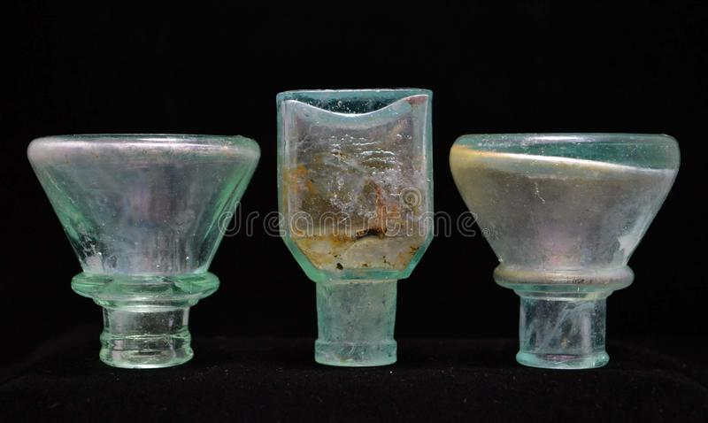 Antique Upside Down Aqua Glass Inkwell Bottles stock photo