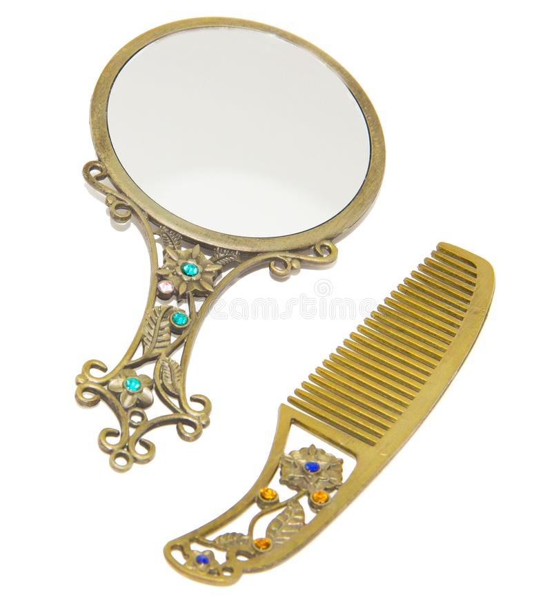 Antique vanity mirror with comb. Pocket size hand held small royalty free stock photo