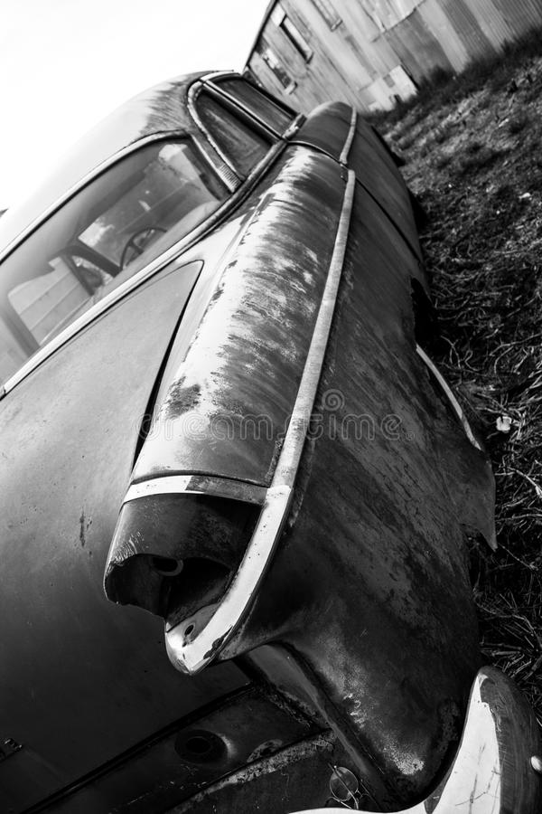 Antique vintage american automobile with a broken tail light royalty free stock photography