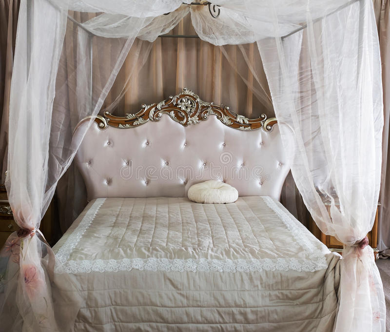 Antique Vintage Bed. Luxury Interior.Antique Vintage Bed stock photography