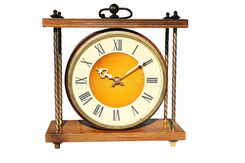 Antique vintage clock Isolated on white background. The clock is a desktop fireplace in a wooden case with bronze elements. mid-20 royalty free stock photo
