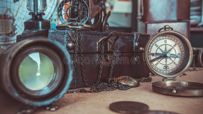 Antique Vintage Compass Maritime Nautical Navigation Photos. Antique Vintage Compass And Wooden Treasure Maritime Nautical Navigation Photos stock photo