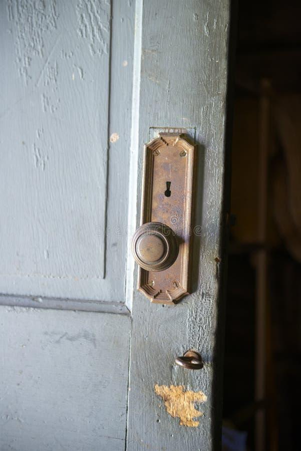 Antique Vintage Farm Door, Doorknob. Antique vintage farm door with doorknob, keyhole, and lock. The farmhouse detail shows the architecture details royalty free stock images