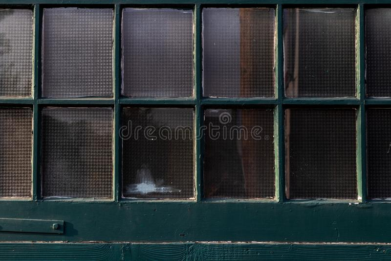 Antique vintage green painted window paine stock image
