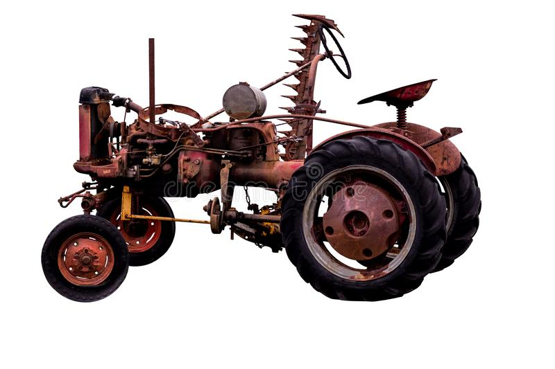 Antique vintage old rusty tractor with implement stock images