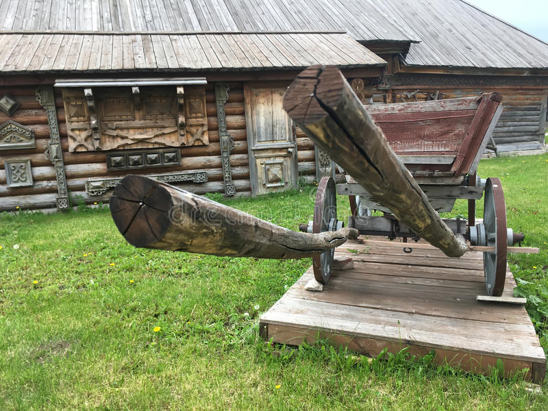 Antique vintage Russian rural peasant cart in the yard of a wooden house.  royalty free stock images