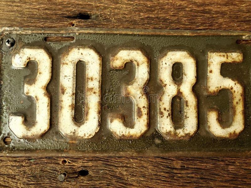 Antique Vintage Rustic License Plate stock photos