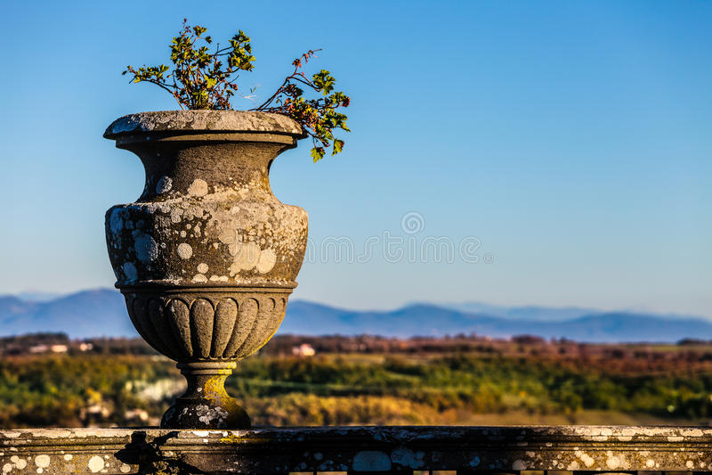 Antique vintage vase, outdoor natural landscape and sky stock image