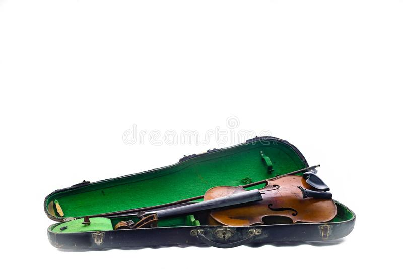 Antique vintage violin in battered old case. Old antique vintage violin in battered old case. Gig worn with patina appropriate to its age; presented on plain stock image