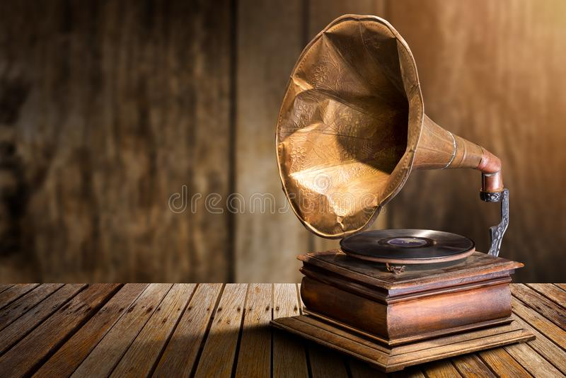 Antique vinyl record player. Antique gramophone vinyl record player on wooden table stock image