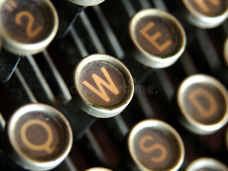 Antique W. W key on dusty, corroded antique typewriter royalty free stock photography