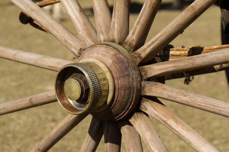 Antique wagon wheel made of wood and bronze royalty free stock photo