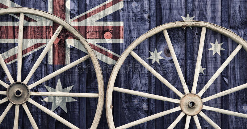 Antique Wagon Wheels with Australia flag royalty free stock images
