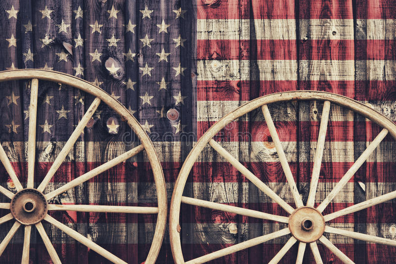 Antique Wagon Wheels with USA flag royalty free stock photo