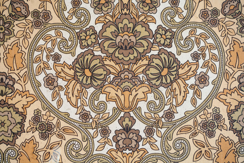 Antique Wallpaper. Detail of the pattern of an Antique Wallpaper with stylized floral design stock images