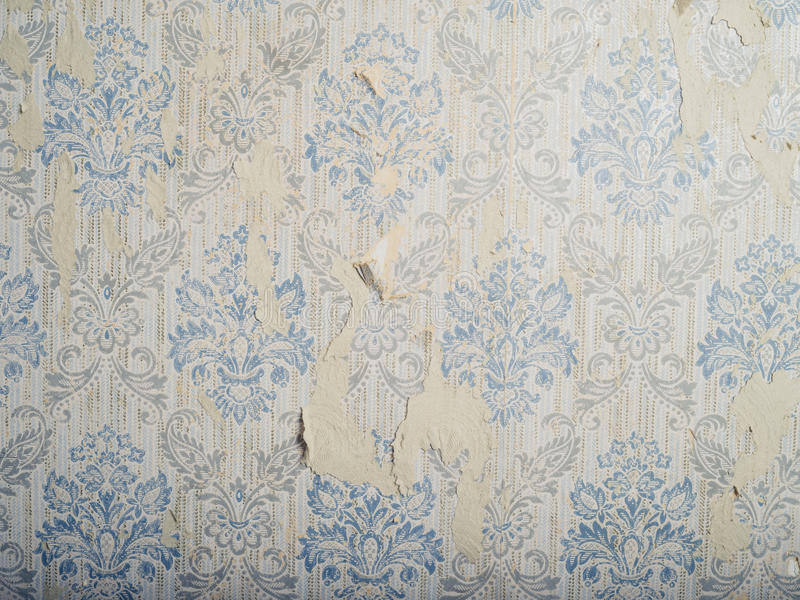 Antique wallpaper. Old and weathered antique wallpaper royalty free stock photo