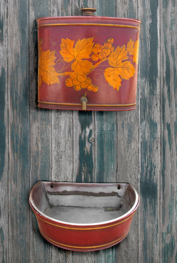 Antique wash sink and water reservoir isolated.