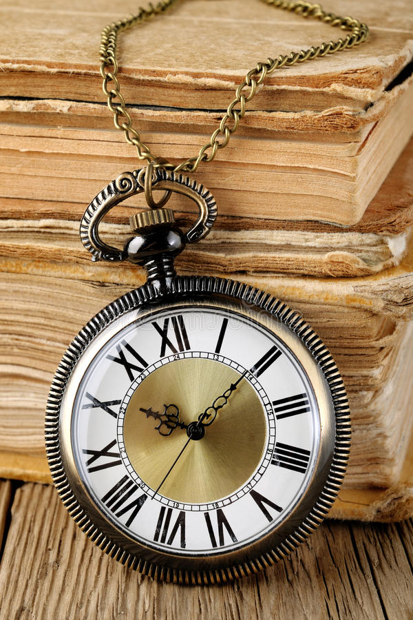 Antique watch. And old books stock image