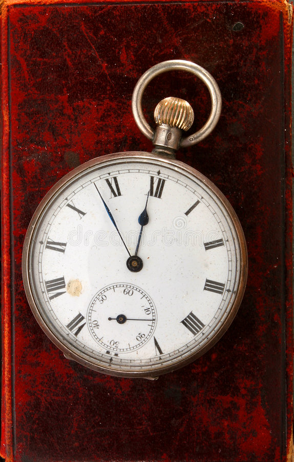 Antique watch on leather. Antique pocket watch on old leather stock images