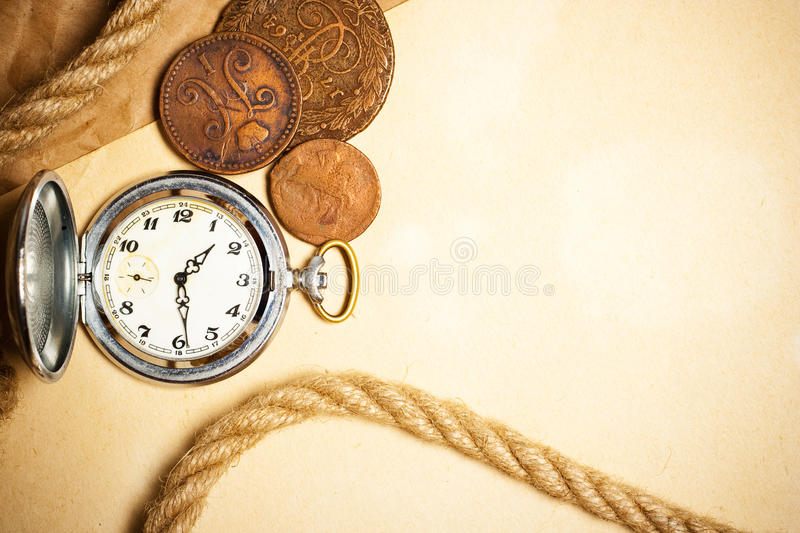 Antique watch and money. On old yellow paper stock image