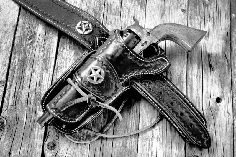 Antique Western pistol. Antique western cowboy pistol in leather holster in black and white royalty free stock photography