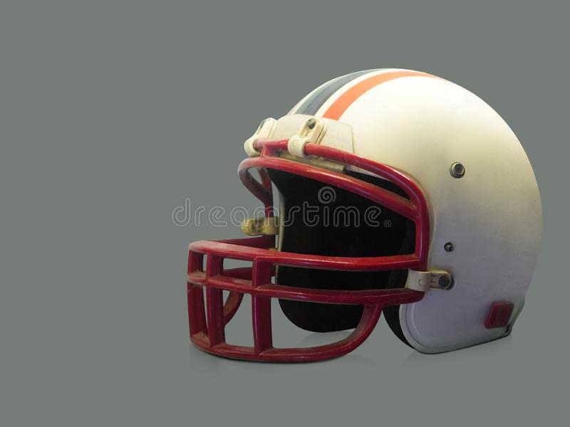 Antique white and red American football helmet on gray background, object, copy space stock photo