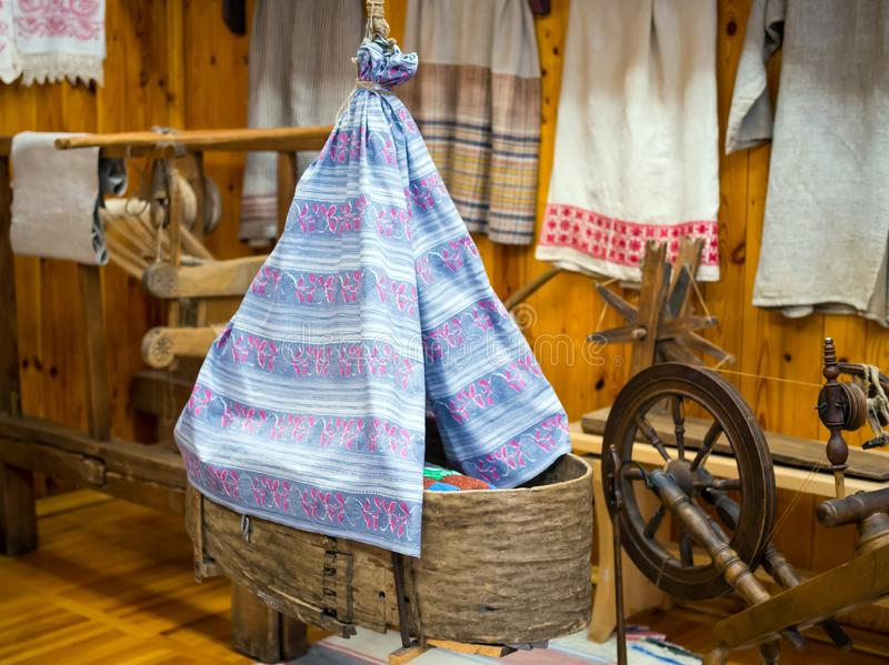Antique wicker baby cradle in the interior of the hut royalty free stock image