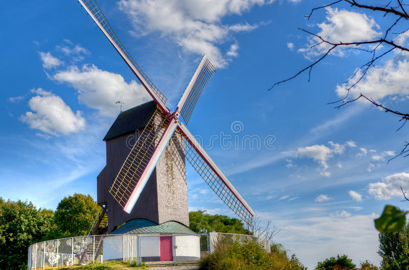 Antique windmill Bruges / Brugge, Belgium. Old wooden windmill in Bruges, Brugge, in Flanders, Belgium stock image