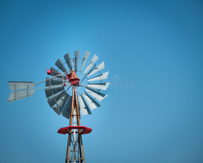 Antique windmill on a texan farm with clear sky on a sunny day royalty free stock photos