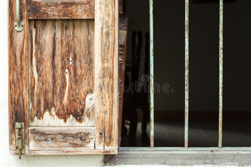 Antique Window And Corroded Bars. A window of an old house opens widely, and is secured from risks by steel bars. This window design is generally seen in the royalty free stock images