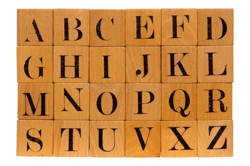 Antique Wood Block Alphabet Letters Isolated. Antique partial wood block alphabet letters toy isolated on white stock photo