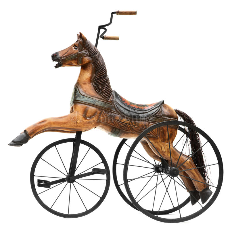 Antique Wood Horse Tricycle Bike. Isolated on White royalty free stock photo