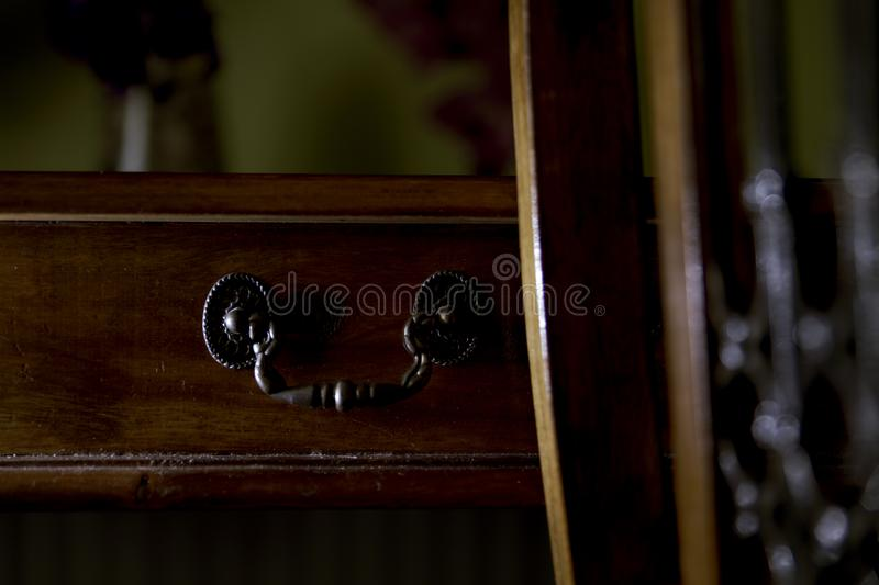 Antique wood table with antique drawer handle royalty free stock photo