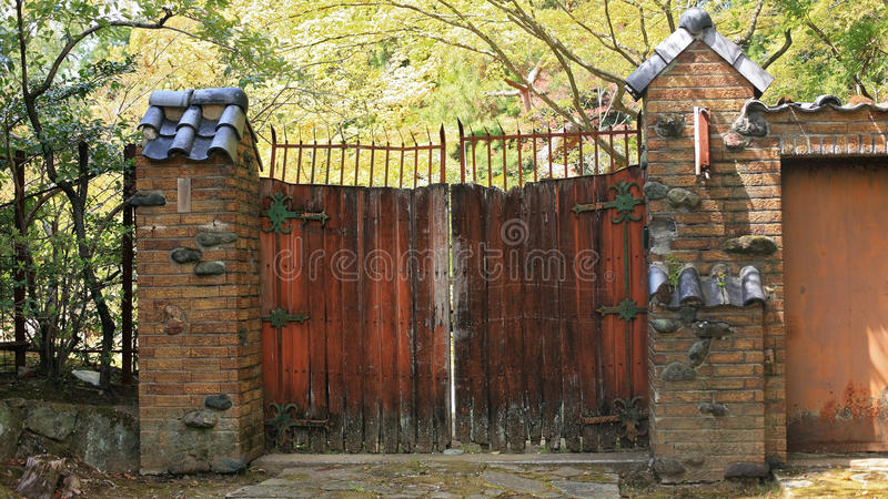 Antique wooden barn gate. Abandoned antique wooden barn gate royalty free stock photo