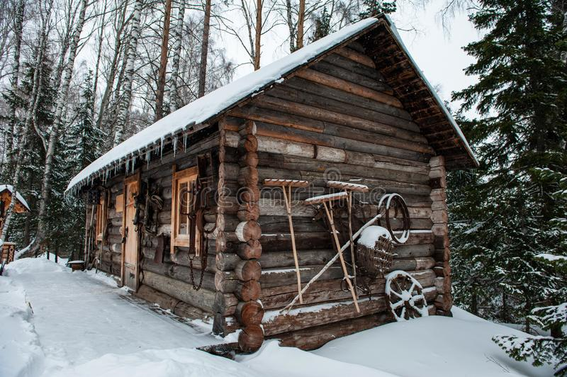 Antique wooden barn house. In winter forest. Retro building of the early 19th century stock photos