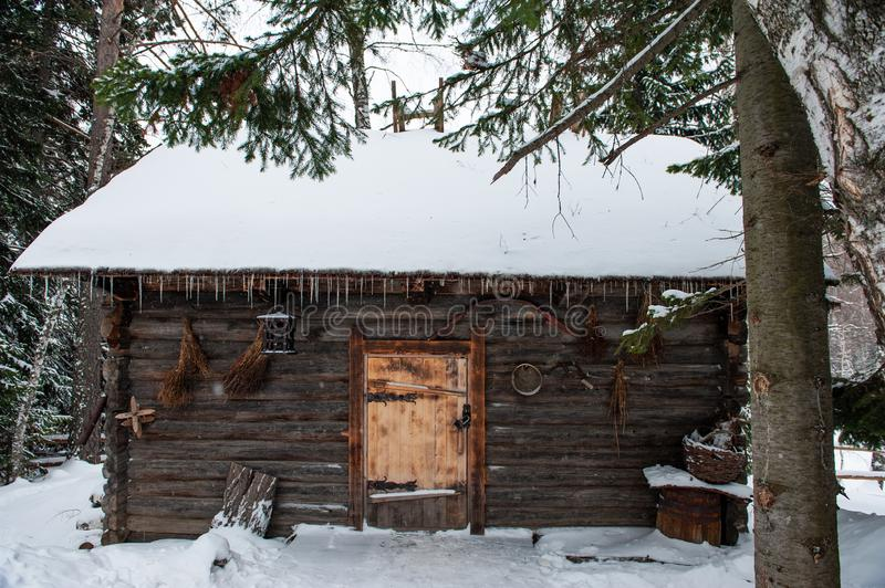 Antique wooden barn house. In winter forest. Retro building of the early 19th century stock photo