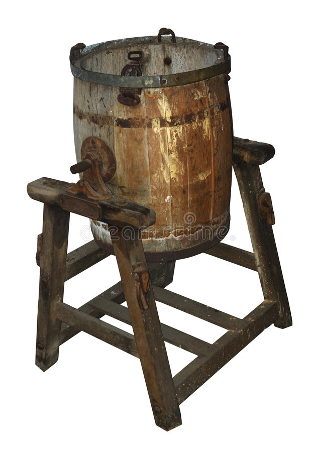 Antique wooden butter churn. Old wooden butter churn on stand, battered and rusty, isolated on white (clipping path included stock photography
