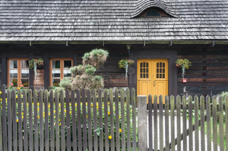 An antique wooden cottage with a log construction without remnants from 1831. Village Kielcza, Opole province, Poland, Europe royalty free stock image