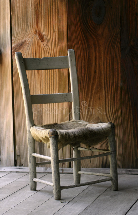 Antique wooden cow hide chair stock photos