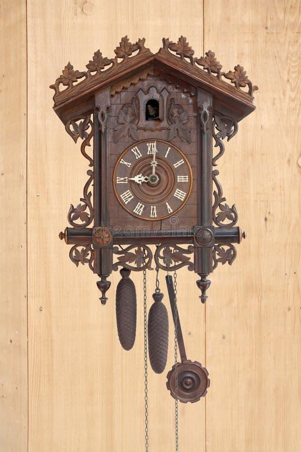 An antique wooden cuckoo clock stock photo