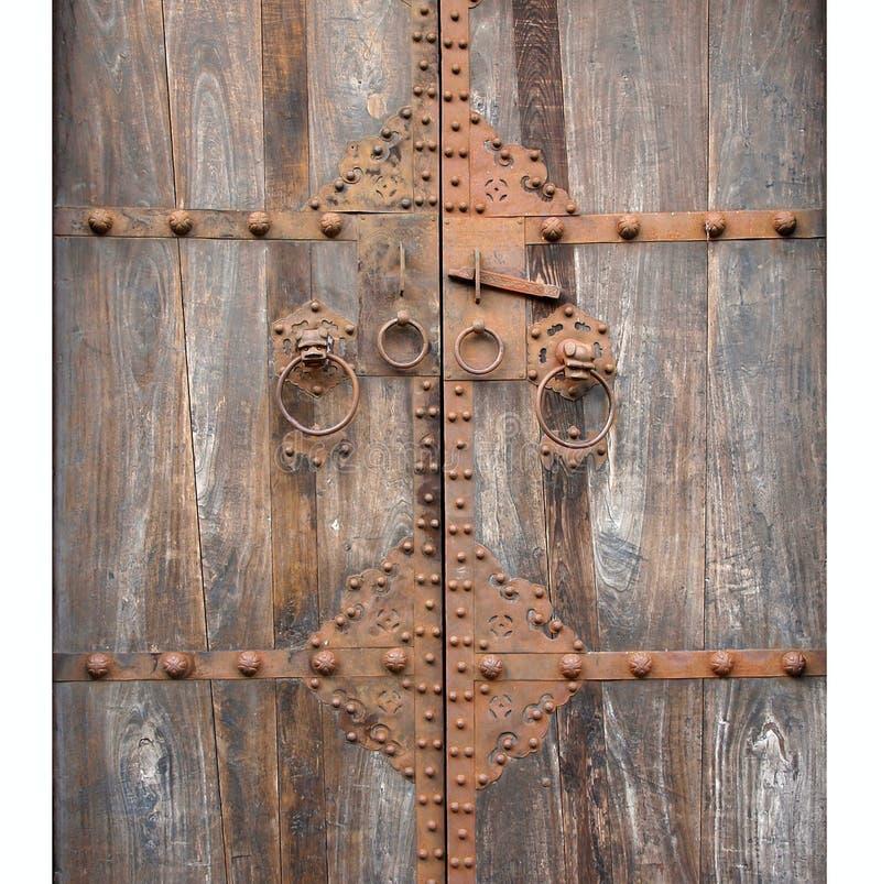 Antique Wooden Door with Bronze royalty free stock image