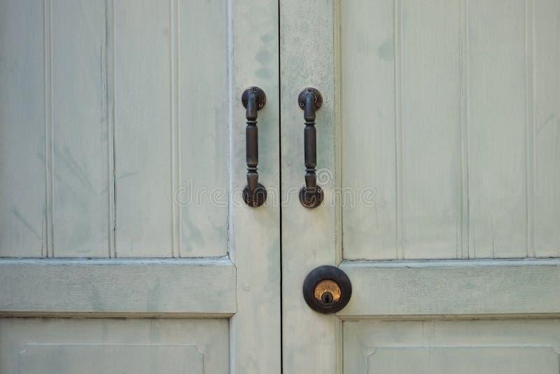 Antique wooden door. The old wooden door have with two door handles steel, shut and lock with the old key and rust stock photos