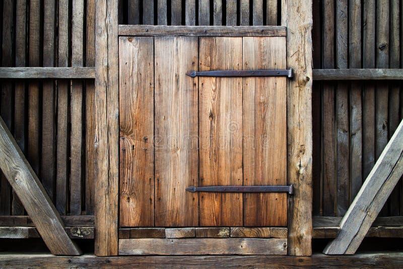 Antique wooden door. Rustic antique wooden door, material construction royalty free stock image