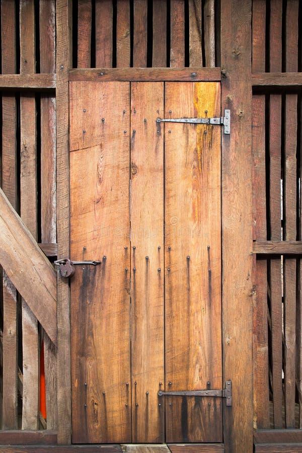 Antique wooden door. Rustic antique wooden door, material construction stock image